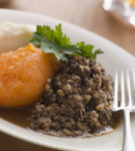 a plate of haggis, neeps and tatties